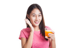 Happy Young Asian woman drink orange juice. Royalty Free Stock Images