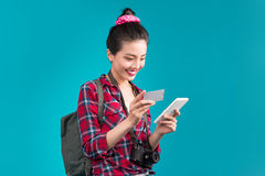 Happy young asian woman holding credit card and smartphone stand Stock Photos