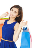 Happy young  asian woman with shopping bags Royalty Free Stock Images
