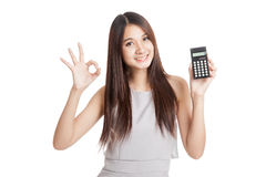 Happy Young Asian woman show OK with calculator Stock Photography