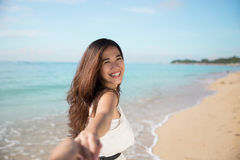 Happy young Asian woman take photos, smile to camera Stock Photo
