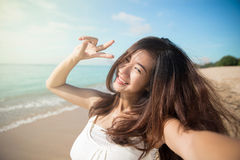 Happy young Asian woman take photos, smile to camera, victory si Stock Images