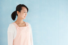Happy young asian woman wearing an apron Stock Photography