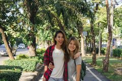 Happy young asian women couple playing to each other while they do city trip. royalty free stock images