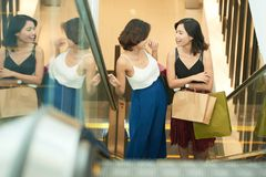 Shopping with best friend. Happy young Asian women enjoying shopping in mall royalty free stock image