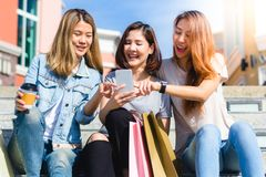 Happy young Asian women group city lifestyle playing and chatting each other among the pastel building city on weekend. Stock Image