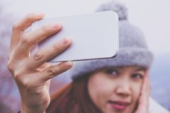 Happy young asian women are looking at her cellphone Royalty Free Stock Photos