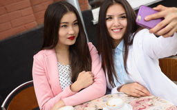 Happy Young asian women making selfie photo on Stock Photography