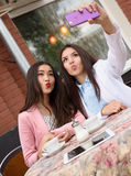 Happy Young asian women making selfie photo on Stock Photo