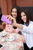 Happy Young asian women making selfie photo on Stock Photos