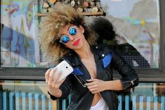 Happy young attractive afro girl selfie. Stylish urban outside spring Royalty Free Stock Photo