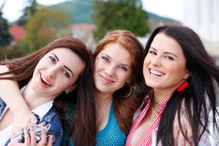 Happy young and attractive girlfriends Royalty Free Stock Image