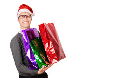 Happy young attractive man wearing Santa hat Stock Photography