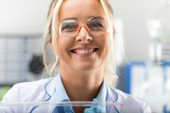 Happy young attractive smiling woman scientist in the laboratory Royalty Free Stock Photography