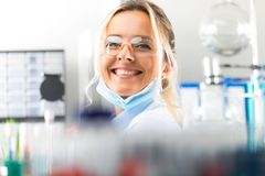 Happy young attractive smiling woman scientist in the laboratory Stock Photos