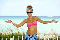 Happy young attractive woman in bikini opening arms at paradise beach Royalty Free Stock Images