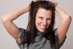 Happy young attractive woman holding her hair Royalty Free Stock Photo