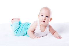 Happy young baby lying on tummy Stock Image