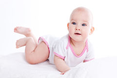 Happy young baby lying on tummy Royalty Free Stock Photo