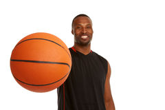 Happy young basketball player with focus on the ball Royalty Free Stock Photography
