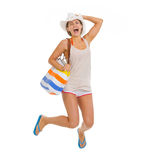 Happy young beach woman in hat jumping Stock Photography