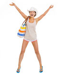 Happy young beach woman in hat jumping Royalty Free Stock Photos