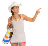 Happy beach woman in hat pointing on copy space Royalty Free Stock Image