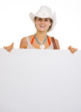 Happy beach woman in hat showing blank billboard Royalty Free Stock Images