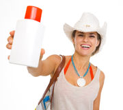 Happy beach woman in hat showing sun block creme Stock Images