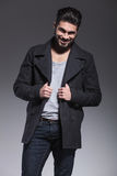 Happy young bearded fashion man is smiling royalty free stock images