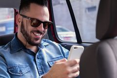 Happy man wearing riding with transportation network company and royalty free stock photo