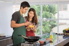 Asian couple at kitchen room royalty free stock photos