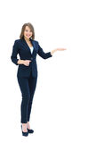 Happy  young beautiful business woman showing blank area for sig. Happy  young beautiful business woman showing palm isolated on white Stock Photo