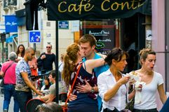 Happy young beautiful couple kissing on the street. France, Paris, October, 04, 2014 royalty free stock images