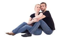 Happy young beautiful couple sitting isolated on white Stock Photo