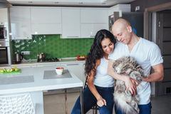 Happy young beautiful couple sitting at kitchen cat smiling. Happy young beautiful couple sitting at kitchen cat smiling Stock Photos