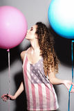 Happy young beautiful girl kissing balloons Stock Photos
