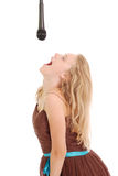 Happy young beautiful girl singing with microphone Royalty Free Stock Image
