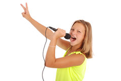 Happy young beautiful girl singing with microphone Royalty Free Stock Photos