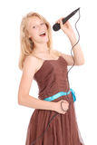 Happy young beautiful girl singing with microphone Royalty Free Stock Photography