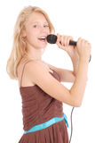 Happy young beautiful girl singing with microphone Stock Image