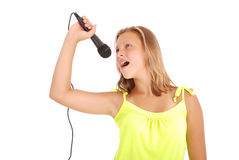 Happy young beautiful girl singing with microphone Stock Images