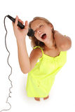 Happy young beautiful girl singing with microphone Royalty Free Stock Images