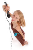 Happy young beautiful girl singing with microphone Stock Photos