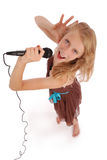 Happy young beautiful girl singing with microphone Royalty Free Stock Photo