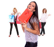 Happy young beautiful girls with bags Royalty Free Stock Images