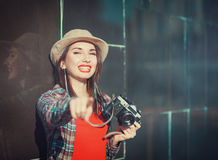 Happy young beautiful hipster girl with retro camera Royalty Free Stock Image