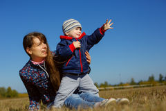 Happy young beautiful mather with baby on nature outdoor Stock Photo
