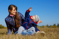 Happy young beautiful mather with baby on nature outdoor Stock Photography