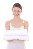 Happy young beautiful slim woman holding towels isolated on whit Royalty Free Stock Photo